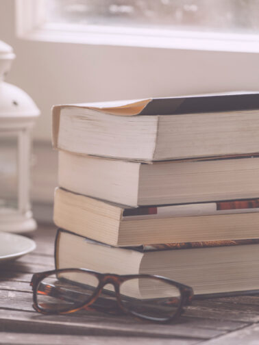Books And Glasses On A Wood Table.