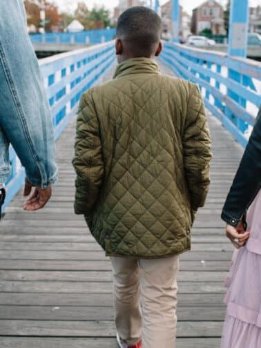 Boy Walking Between His Parents